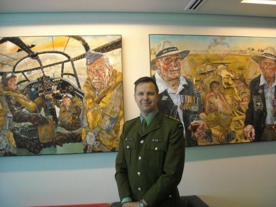 Matt Gauldie with two of his paintings